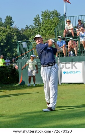 EDISON,NJ-AUGUST 26: Golfer Ernie Els watches his shot during the second round of the Barclays Tournament held at the Plainfield Country Club on August 26, 2011 in Edison, N.J.