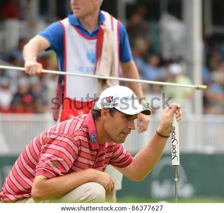 EDISON,NJ-AUGUST 27:Golfer Padraig Harrington lines up his putt on the 18th hole during the final round of the Barclays Tournament held at the Plainfield Country Club on August 27,2011 in Edison,NJ. - stock photo