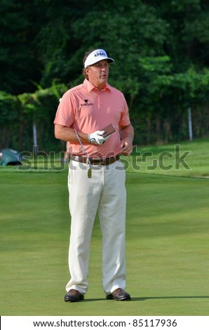 EDISON,NJ-AUGUST 24: Golfer Phil Mickelson watches his shot during the Barclays pro-am held at the Plainfield Country Club on August 24,2011 in Edison,NJ.