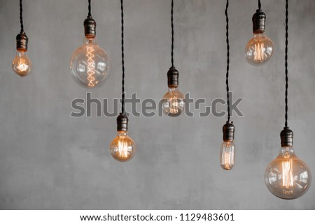Edison retro lamp Incandescent bulbs on gray plaster wall background