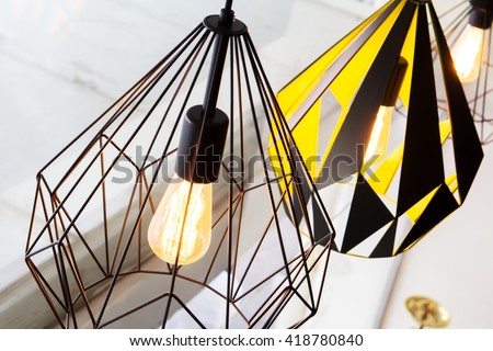 Shutterstock Edison's light bulb and lamp in modern style. Warm tone light bulb lamp. Lamps in coffee shop. Edison's lightbulb in interior.