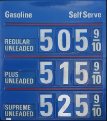 Edited gas station sign showing gas at $5 per gallon, from directly facing sign.