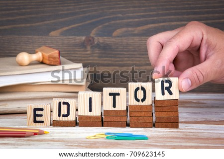 Editor concept. Wooden letters on the office desk, informative and communication background
