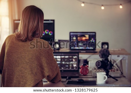 Editor video woman working with footage video on laptop and computer pc in the house studio of lifestyle freelance                              #1328179625