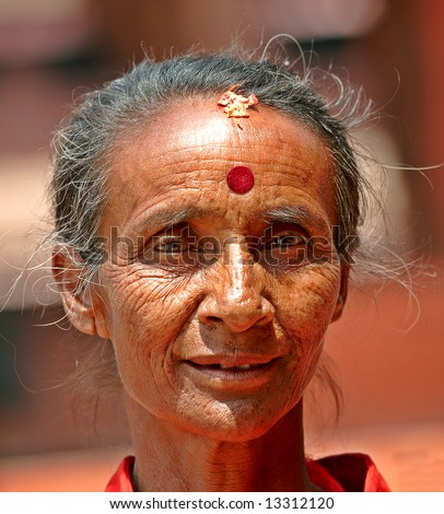 Editorial: An old hindu woman with strong eyes (Nepal)