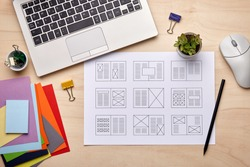 Editorial design. Graphic designer desk with magazine layout designs. Flat lay
