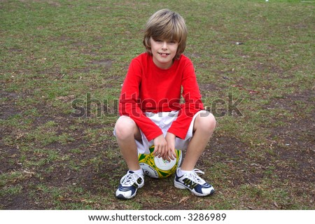 Editorial Logos On Australian Soccer Ball Model Release For Boy ...