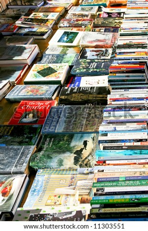 Editorial photo of books covers on the stalls - stock photo