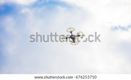 Editorial quad copter without Logo and TM. Flying drone with stabilizer camera flying in the blue sky with white clouds at the festival 10 June 2017 Vinnytsia, Ukraine. Illustrative photo.