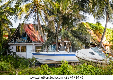 Editorial - San Andres, Colombia, January 2014. San Andres is a coral island in the Caribbean Sea where lots of Tourists come for Vacations. here is a Destroyed House with boats