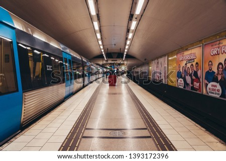 Editorial 03.27.2019 Stockholm Sweden. Train leaving the subway platform at Medborgarplatsen station #1393172396