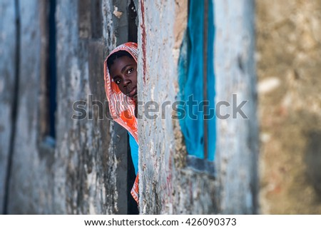 Editorial use. Children in Africa face poor life conditions and health issues. However, they are curious, joyful and eager to play. Zanzibar Island, Tanzania, Circa April 2016