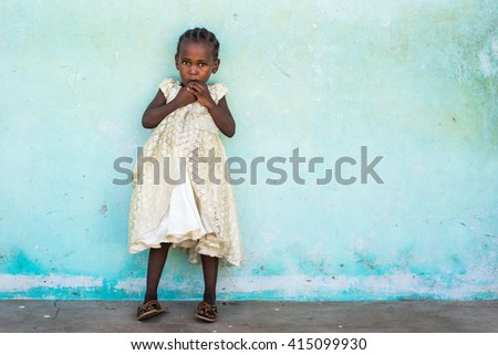 Editorial Use: Girl at school in Zanzibar, Tanzania, 04.2016. Children face tremendously poor life conditions in Africa but the interest in education is high. They are curious, witty and smart.