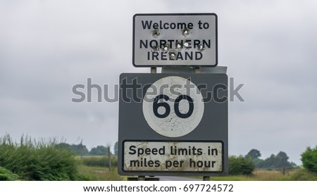 Editorial use only; a Welcome to Northern Ireland, cross border sign, riddled with bullet holes, taken at Ballyconnell, Co. Cavan, Ireland, on July 25th, 2017.