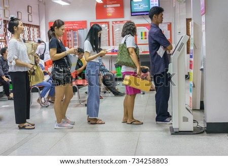 Editorial use only; people queueing at a post office at Sriracha, Chonburi, Thailand, taken on September 27th, 2017.