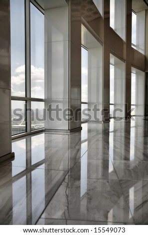 Editorial Use Only: Tall Marble Interior with Office Windows Looking out over Downtown Houston