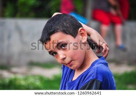Editorial use. The Tatars are Turkic people striving to keep their traditions in small communities in Eastern Europe. Image of a Tatar boy taken in the remote village of Hagieni, Romania, June 2014. #1260962641