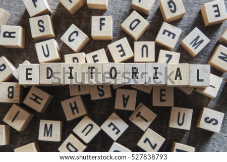 EDITORIAL word concept - Shutterstock ID 527838793