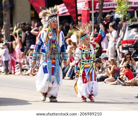 EDMONTON, AB, CANADA-July 18, 2014: People in traditional Native American clothing as seen in the K-Days Parade on July 18th, 2014.