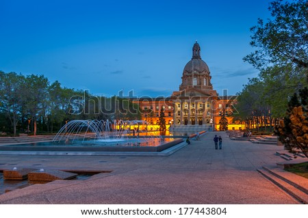 EDMONTON, AB, CANADA - MAY 29: People enjoy a warm evening in front of the Alberta Legislature Building on May 29, 2008 in Edmonton, Alberta Canada. In the foreground are the fountains.