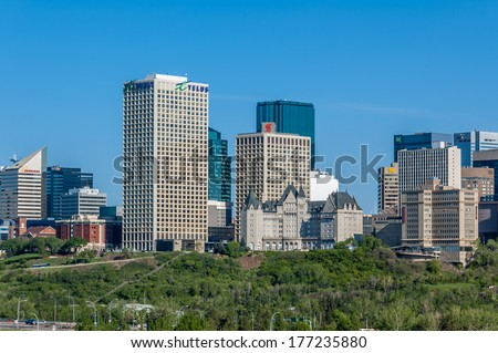 EDMONTON, AB, CANADA - MAY 28: Skyline and office towers on May 28, 2008 in Edmonton, Alberta, Canada. In the foreground is the green trees of the Saskatchewan River valley.