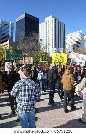 EDMONTON, AB - OCTOBER 15: Protesters at an occupy Edmonton rally carry signs ad protest in support of similar rallies on October 15, 2011 in New York and around the world.