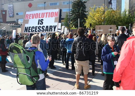 EDMONTON, AB - OCTOBER 15: Protesters at an occupy Edmonton rally on October 15 carry signs ad protest in support of similar rallies in New York and around the world.