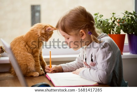 Educate at home. Child girl make homework with pet cat. Funny ginger kitten sitting on table where kid is writing. Back to school.