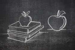 educated apples learned apples on top of books, white chalk on a blackboard
