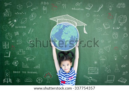 Educated school child girl kid lifting world globe and graduation cap chalk doodle drawing on green chalkboard background celebrating success for children's education concept on World literacy day #337754357