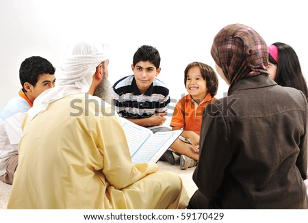 Education activity in Ramadan Muslim arabic couple and children reading Koran