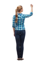 education and advertising concept - young woman from the back writing something in the air