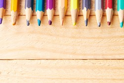 education and creativity concept. color variation. colored pencils over wooden desk background.