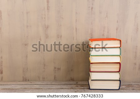 Education and reading concept - group of colorful books on the wooden table #767428333