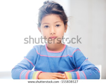 education and school concept - little student girl at school