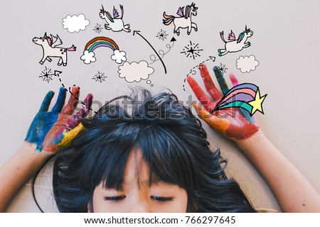 Stock Photo Education , art and creativity learning concept - A black long hair asian student put her colourful hands painting up