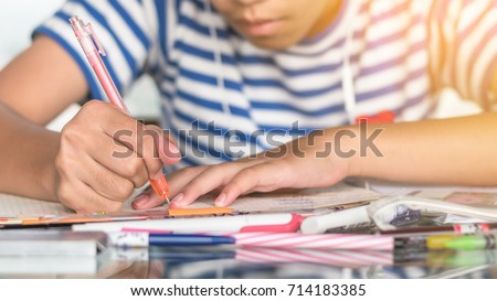 Education, back to school and literacy day concept with girl kid student studying doing homework writing on desk