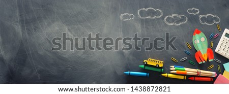 education. Back to school concept. rocket cut from paper and painted over blackboard background. top view, flat lay. banner Foto d'archivio ©