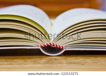 Education book on table in library