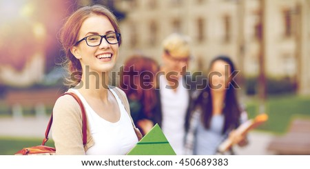 Shutterstock education, campus, friendship and people concept - group of happy teenage students with school folders