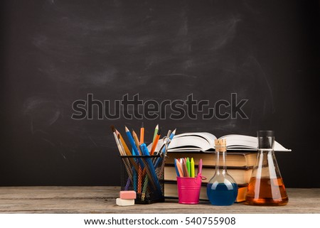 Education concept - books on the desk in the auditorium #540755908