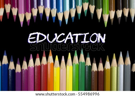 Education Concept : Education on blackboard with colorful pencils as a frame. #554986996