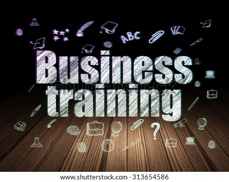 Education concept: Glowing text Business Training,  Hand Drawn Education Icons in grunge dark room with Wooden Floor, black background