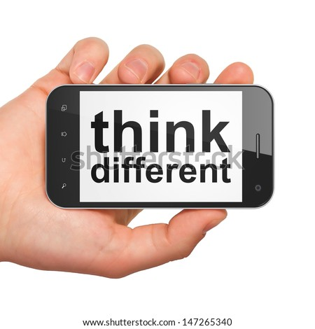 Education concept: hand holding smartphone with word Think Different on display. Generic mobile smart phone in hand on White background.