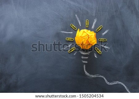 Education concept image. Creative idea and innovation. Crumpled paper as light bulb metaphor over blackboard Photo stock ©
