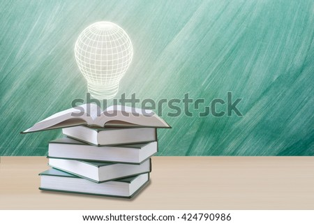 education concept,lamp over open book with green chalkboard.education book concept,education concept background.education concept with lamp   #424790986