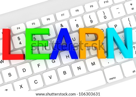 Education concept. Learn Colour letters on a white keyboard