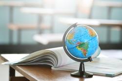 Education concept,Modeled globe with geography books on the table.Study of maps and using geographic tools.Innovative teaching materials for objects.Learning management in the 21st century.