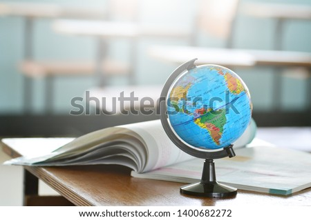 Education concept,Modeled globe with geography books on the table.Study of maps and using geographic tools.Innovative teaching materials for objects.Learning management in the 21st century. Photo stock ©