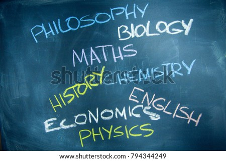 Education concept: Names of school subjects inscribed on a black chalkboard with colored chalks #794344249
